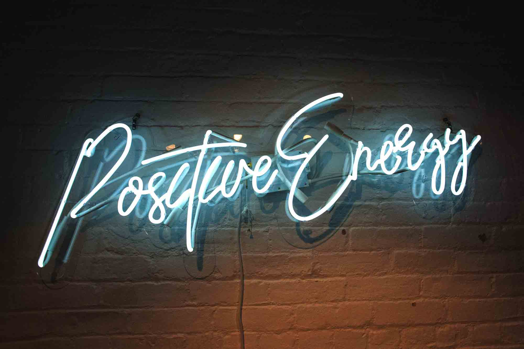 neon sign with the words Positive Energy